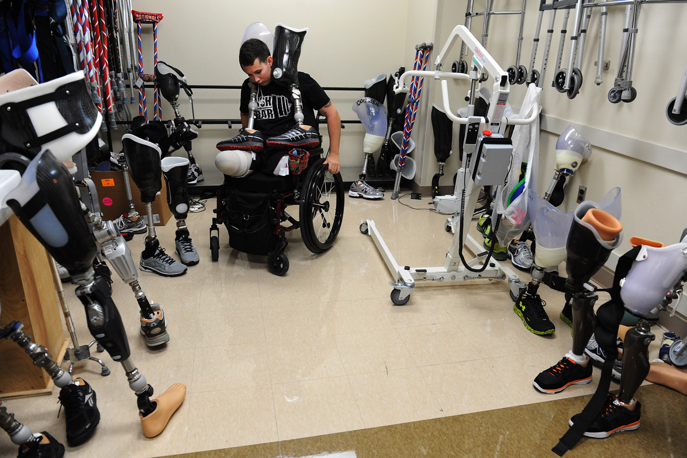 U.S. Army Staff Sgt. Sam Shockley prepares to work on his balancing and walking with prosthetic legs as he rehabs on Friday May 09, 2014 in Bethesda, MD.  Shockley lost his legs and sustained other injuries while serving in Afghanistan.  (Photo by Matt McClain/ The Washington Post)