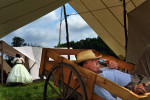 Tony Stracuzzi of Stuart, FL relaxes in a wagon as he smokes a pipe prior to a reenactment of Pickett's Charge that was put on by the Blue Gray Alliance on Sunday June 30, 2013 outside of Gettysburg, PA.  This is one of several events that is commemorating the 150th anniversary of the Battle of Gettysburg.  Considered a major event of the Civil War.  (Photo by Matt McClain/ The Washington Post)