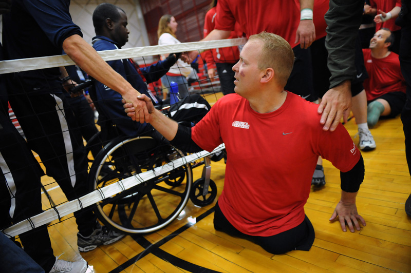 Travis Greene, center, is congratulated following a volleyball match for the Marines against Navy during the 2010 Warrior Games for wounded soldiers on Wednesday 05/12/10 at the U.S. Olympic Training Center in Colorado Springs, Colo.  Photo by Matt McClain