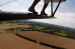 High above the ground, Chuck Tippett performs as a wing walker during the Flying Circus Airshow on Sunday June 29, 2014 in Bealeton, VA.  The show harkens back to vintage barnstorming.  (Photo by Matt McClain/ The Washington Post)