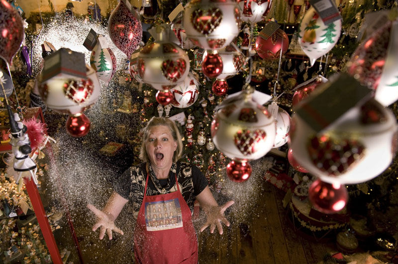 Cheri Hennessy, owner of The Christmas Attic poses for a portrait while surrounded by ornaments in her year round Christmas store on Wednesday October 26, 2011 in Alexandria, VA.  (Matt McClain for the Washington Post)