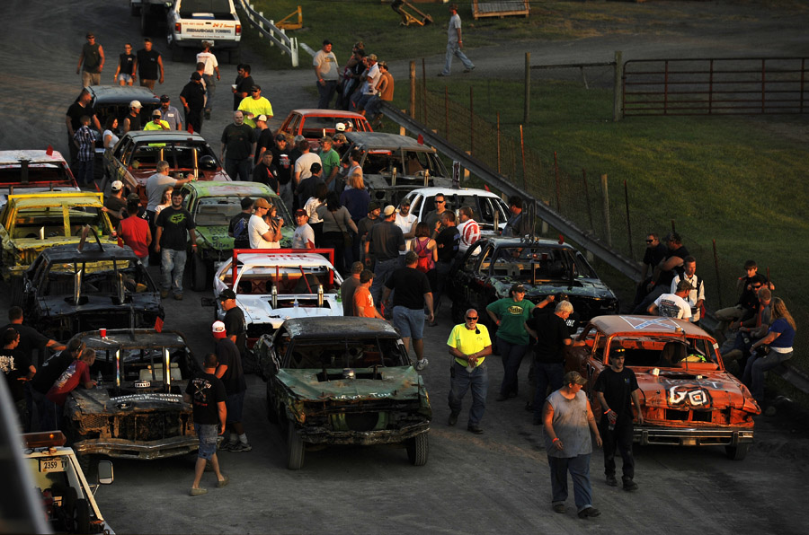 Demolition derby cars sit lined up for their respective heats prior to the beginning of the demolition derby at the Shenandoah County Fair on Tuesday August 28, 2012 in Woodstock, VA.