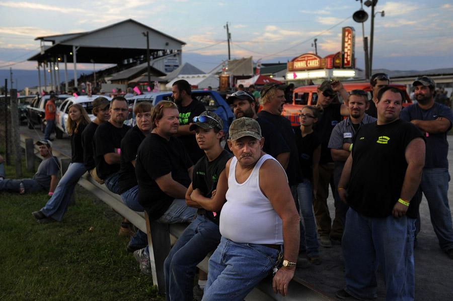 Demolition derby drivers gather for a meeting that listed the rules and regulations prior to the first heat of the demolition derby at the Shenandoah County Fair on Monday August 27, 2012 in Woodstock, VA.  There were two nights that featured the derby.