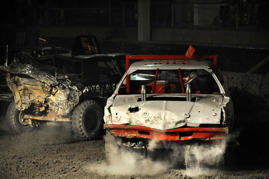 Bill Orndorff, right, competes in the demolition derby at the Shenandoah County Fair on Tuesday August 28, 2012 in Woodstock, VA.