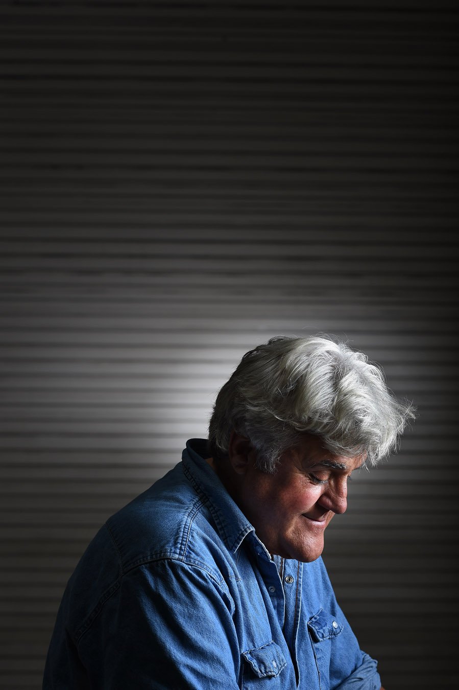 Jay Leno poses for a portrait at his car garage on Wenesday September 24, 2014 in Burbank, CA.  The longtime host of The Tonight Show, continues to tour extensively performing comedy.  Leno is going to be the next recipient of the Mark Twain Prize for American Humor.  (Photo by Matt McClain/ The Washington Post)