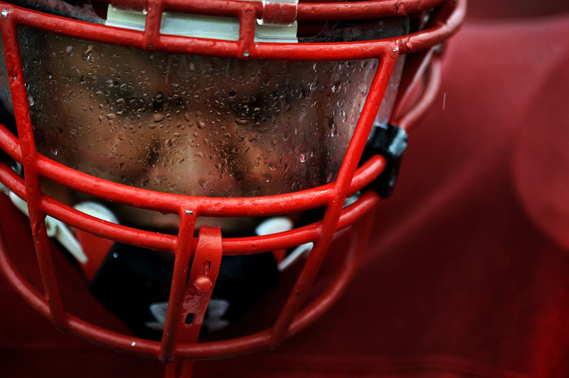 Rain is seen on the face shield of Arvada's Donovan Jimenez on the sidelines during a game against Holy Family on Friday 10/22/10 at the North Area Athletic Center in Golden, Colo.  Photo by Matt McClain