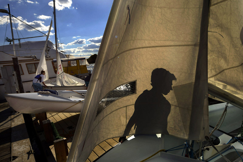 George Danforth, 17, helps his sailing partner prepare their vessel as he takes part in DC Sail's high school racing program at the Gangplank Marina on Monday September 10, 2012 in Washington, DC.  Temperatures in the 70's were more fall than summer like.  (Photo by Matt McClain for The Washington Post)