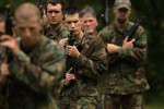 Nick Whalen, left to right, Chris Griffin, Benjamin Chworowsky, Mark Parris, and John Speaker participate in a drill while taking part in the Extreme SEAL Experience on Tuesday May 17, 2011 in Chesapeake, VA.  Men from around the country paid money to learn techniques used in Navy SEAL training.   (Photo by Matt McClain/For The Washington Post)