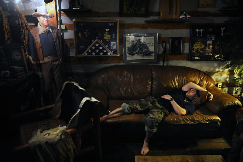 Reid Quaiff, 26, of Richmond, VA rests on a couch during a break in training while taking part in the Extreme SEAL Experience on Tuesday May 17, 2011 in Chesapeake, VA.  Men from around the country paid money to learn techniques used in Navy SEAL training.   (Photo by Matt McClain/For The Washington Post)