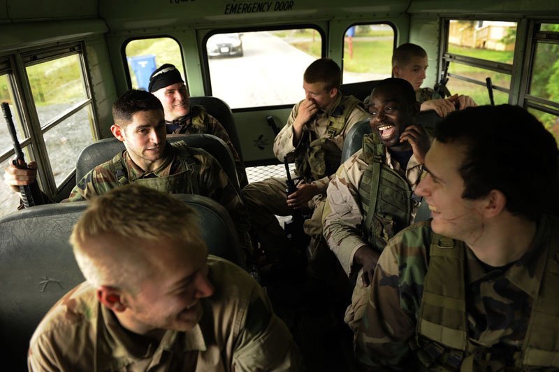 Participants of the Extreme SEAL Experience laugh together on a bus as they return to where they were staying after taking part in training drills on Tuesday May 17, 2011 in Chesapeake, VA.  The men learned how to search buildings and also took part in battle scenarios using air guns. People from around the country paid money to learn techniques used in Navy SEAL training.   (Photo by Matt McClain/For The Washington Post)