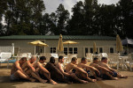 Participants of the Extreme SEAL Experience sit together to stay warm during pool exercises on Wednesday May 18, 2011 in Chesapeake, VA.  Men from around the country paid money to learn techniques used in Navy SEAL training.  (Photo by Matt McClain/For The Washington Post)