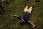 Showing his enjoyment, Darion Brown, 36, of California lays on the ground after firing a 50 caliber sniper rifle while taking part in the Extreme SEAL Experience on Wednesday May 18, 2011 in Chesapeake, VA.  Men from around the country paid money to learn techniques used in Navy SEAL training.   (Photo by Matt McClain/For The Washington Post)