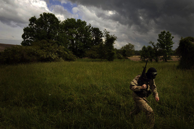 D.J. Jalving, 19, of Redlands, CA walks through a field while taking part in the Extreme SEAL Experience on Tuesday May 17, 2011 in Chesapeake, VA.  Men from around the country paid money to learn techniques used in Navy SEAL training.   (Photo by Matt McClain/For The Washington Post)
