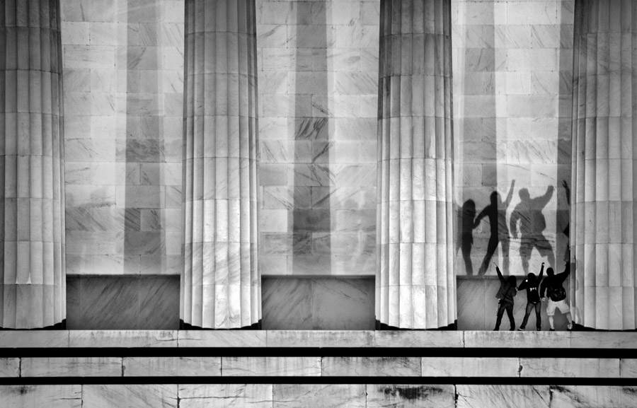 People and their shadows are seen at the Lincoln Memorial on Thursday March 29, 2012 in Washington, DC.
