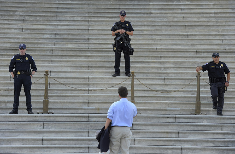 Eric Homan talks to police outside the United States Capitol during the government shutdown on Tuesday October 01, 2013 in Washington, DC.  (Photo by Matt McClain/ The Washington Post)