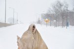 Michael Bond walks on Highway 50 on Saturday January 23, 2016 in Arlington, VA. A large snow event was being predicted for Washington, DC area. (Photo by Matt McClain/ The Washington Post)