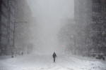 In nearlywhite out conditions, a person makes their way up I Street NW street on Saturday January 23, 2016 in Washington, DC. A large snow event was being predicted for Washington, DC area. (Photo by Matt McClain/ The Washington Post)