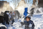 Linden Tarrant, 9, takes part in a large snowball fight in Dupont Circle on Sunday January 24, 2016 in Washington, DC. The Washington, DC area was blanketed by a large snow event. (Photo by Matt McClain/ The Washington Post)