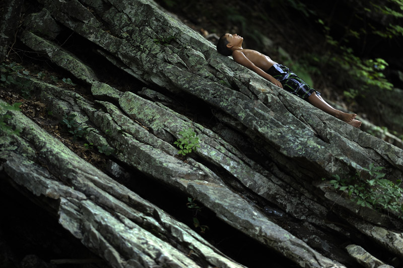 Preston Junkin, 8, lays out on a rock while he and his brother and their friend take a dip in Passage Creek within the George Washington National Forest outside of Front Royal, VA on Tuesday July 17, 2012.  There are other swimming holes in Passage Creek in close proximity.  (Photo by Matt McClain for The Washington Post)