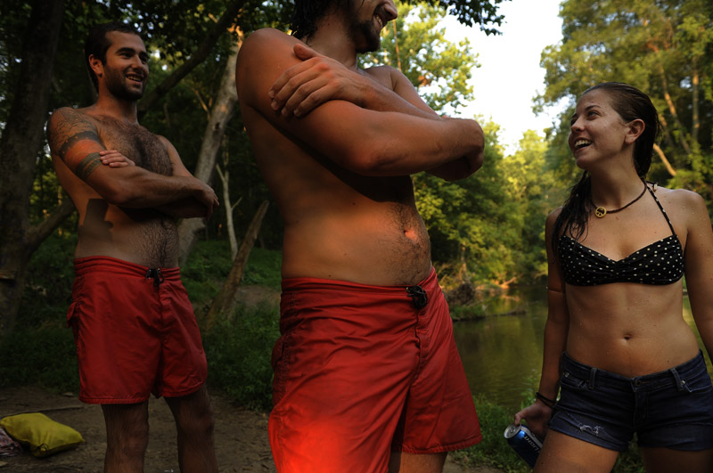 Tony Prilola, left, Justin Horvath, center, and Emily Cardaro, right, take a break from cooling off in the Patapsco River in Carroll County, MD on Monday July 16, 2012.  The swimming spot has a rope swing.  (Photo by Matt McClain for The Washington Post)
