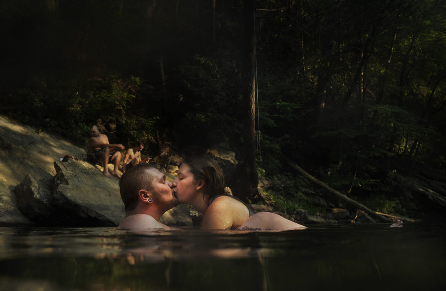 Satchal McClellan, 19, kisses Alexis Chamot, 18, as they cool off in Passage Creek within the George Washington National Forest outside of Front Royal, VA on Thursday August 02, 2012.  There are other swimming holes in Passage Creek in close proximity.  (Photo by Matt McClain for The Washington Post)