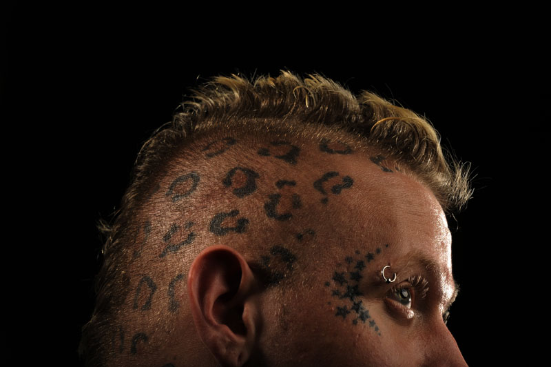 Tattooed stars and spots decorate the head of Sean {quote}Halo{quote} Jankowski, 27, of Brooklyn, MD as he poses for a portrait while taking part in the 2011 DC Tattoo Arts Expo at the Doubletree Hotel Washington DC- Crystal City in Arlington, VA on January 14, 2011.  Jankowski sees his tattoos as accessories on his body.  The event concludes Sunday and includes over 100 tattoo artists.