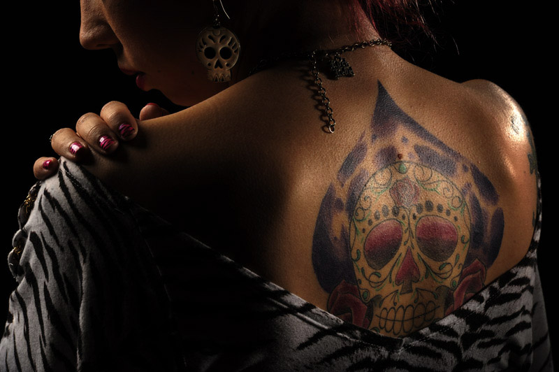 Kaitlyn Cooper, 25, of Baltimore, MD poses for a portrait while taking part in the 2011 DC Tattoo Arts Expo at the Doubletree Hotel Washington DC- Crystal City in Arlington, VA on January 14, 2011.  The tattoo was inspired from the sugar skulls that are associated with the Day of the Dead.  The event concludes Sunday and includes over 100 tattoo artists.  (Photo by Matt McClain/The Washington Post)