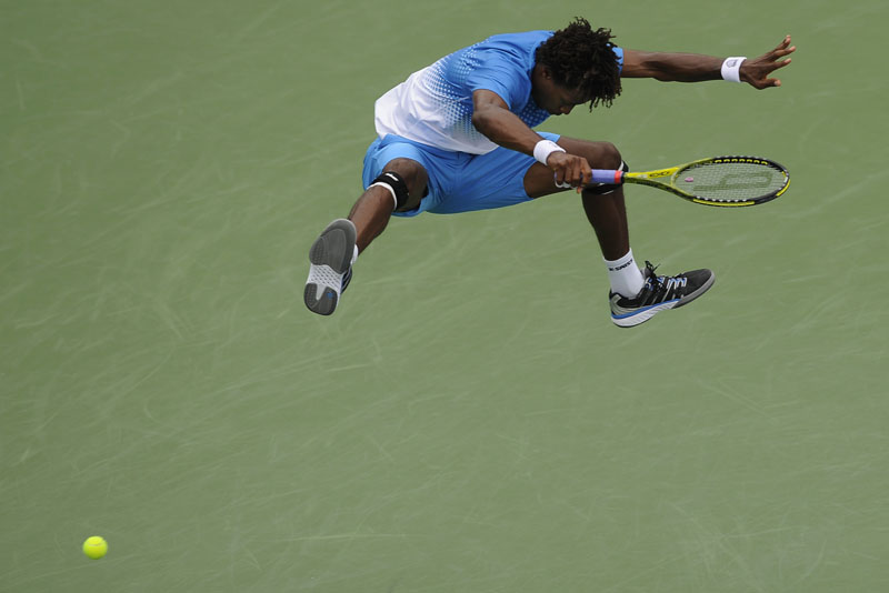 Gael Monfils leaps up in the air to avoid a ball hit by Radek Stepanek that was going out of bounds during the singles final of the Legg Mason Tennis Classic at the William H.G. FitzGerald Tennis Center in Rock Creek Park on Sunday August 7, 2011 in Washington, DC.  Stepanek won in straight sets, 6-4, 6-4.  (Photo by Matt McClain/For The Washington Post)