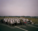 Abandoned chairs from a celebration hall sit in an empty parking lot in the town of Odaka town, Minamisoma, about 8 miles north from the Daiichi nuclear power plant. Mar. 2014