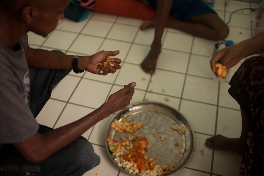 Somalian asylum-seekers eat food in their one room apartment in a low income building occupied by asylum-seekers. They have been seeking asylum in Bangkok for almost 2 years. They live together not far from one of the main buildings. They can't work due to their expired visas, so food and medical assistance is often very difficult to find. Many Somalian people who are seeking asylum in Bangkok, have been forced to leave their homeland because their tribe was often targeted as the minority and their lives were threatened. Many of them have lost all of their family members due to the on-going violence. Apr. 2015
