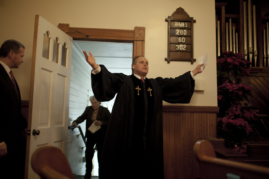 Rev. John, enters the Presbyterian Church to begin a service of reberence and celebration for Edward Frampton in Summerville, SC, Dec. 21, 2014