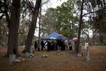 Family and friends gather and grieve while they pay their respect to Edward Frampton at the White Church Cemetey in Summerville, SC. Dec. 21, 2014