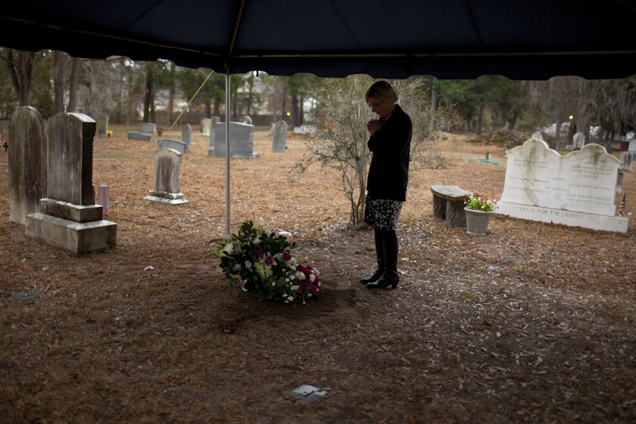 Chris prays and says her final goodbyes to her father on Sunday, Dec. 21, 2014