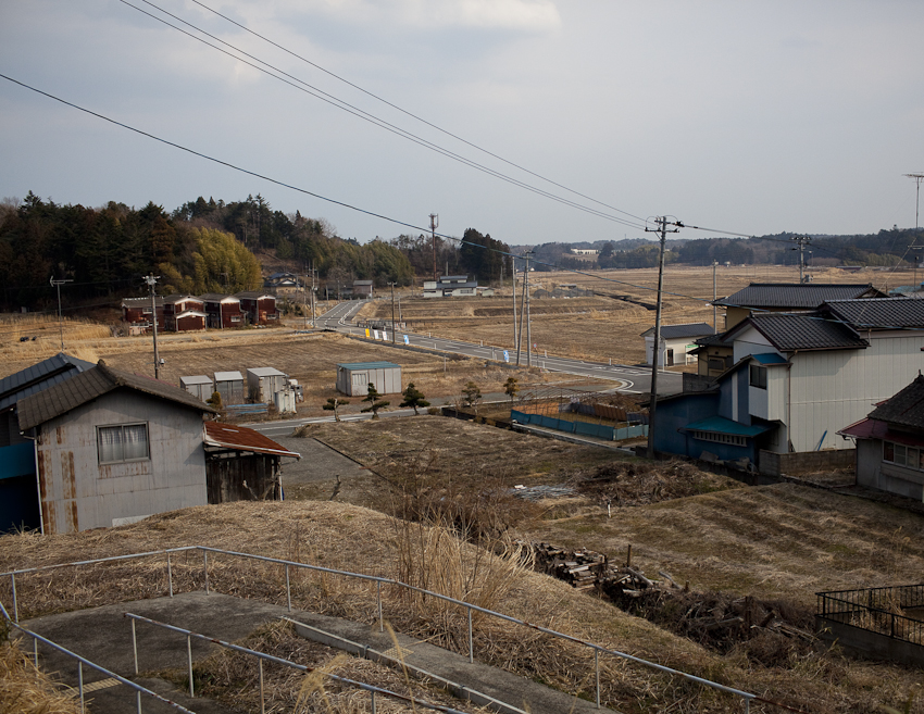 Abandoned homes sit in an empty radiation-contaminated farmland near the Momouchi Station, about 6 miles from the Daiichi nuclear power plant. Mar. 2014