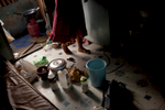 An asylum-seeker from Sri Lanka prepares dinner for her husband and her two small children. They all sleep together in one bed. They have about a year long wait until their visa application interview. Apr. 2015