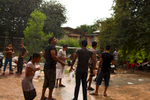 A group of asylum-seekers enjoy a day of water festivities in front of their building during Songkran, Thai New Year. Apr. 2015