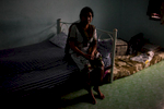 Sakeena, an asylum-seeker from Lahore, Pakistan, and mother of Asad, 22, who was arrested for having an expired visa at a nearby seven eleven store on the outskirts of Bangkok. He has been detained for 5 months inside the Immigration Detention Center. Sakeena and her husband wait patiently inside their room, hoping to receive any news regarding their son. They were recently scheduled for their visa application interview, but it was pushed ahead another six months. Mar. 2015