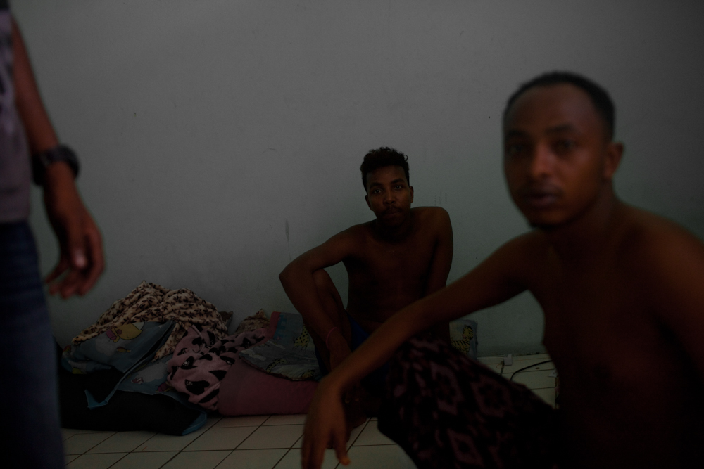 Somalian asylum-seekers in their one bedroom apartment. They have been seeking asylum in Bangkok for almost 2 years. They live together not far from one of the main buildings. They can't work due to their expired visas, so food and medical assistance is often very difficult to find. Many Somalian people who are seeking asylum in Bangkok, have been forced to leave their homeland because their tribe was often targeted as the minority and their lives were threatened. Many of them have lost all of their family members due to the on-going violence. Apr. 2015