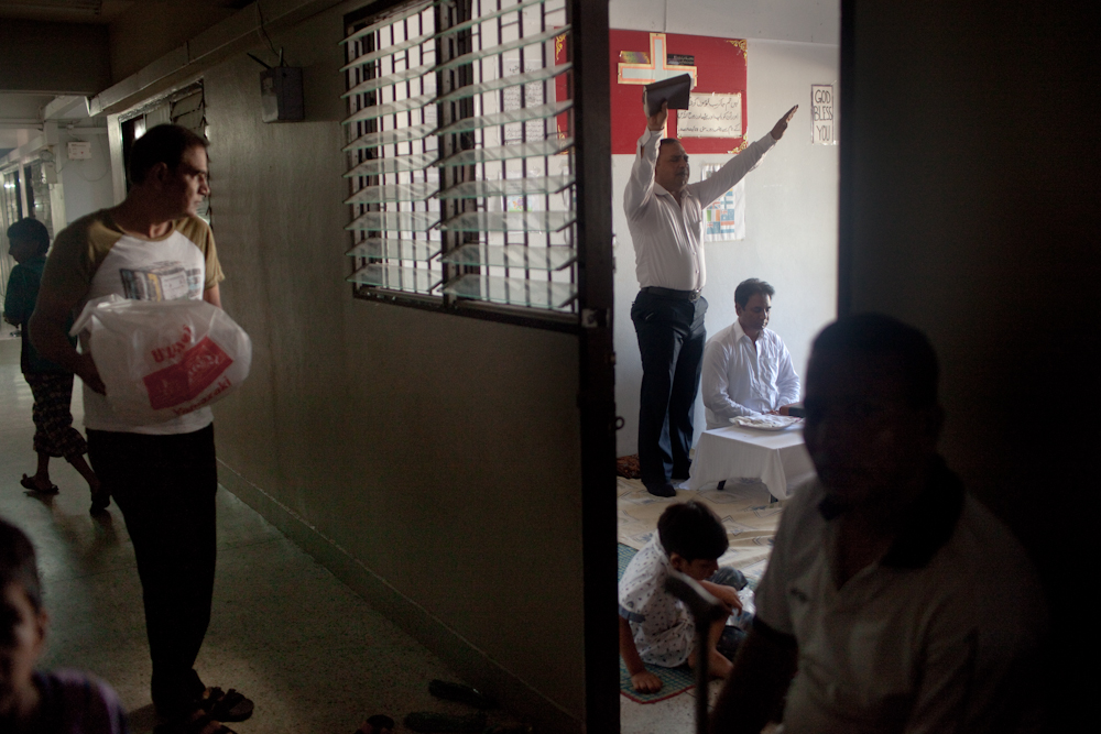 A group of Christians from Pakistan celebrate Easter Sunday, at a low income building occupied by asylum-seekers on the outskirts of Bangkok. Christians and Ahmadi Muslims, and other religious groups seeking asylum in the building usually get along with eachother. April 5, 2015