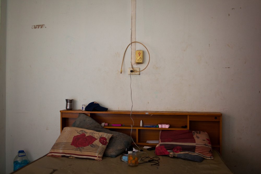 The bed of an asylum-seeker from Pakistan, who has been living inside this room since Dec 2013. Mar. 2015