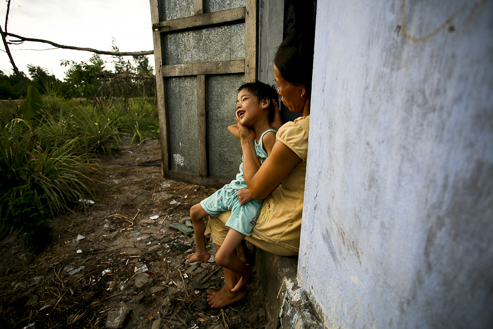Huong Nghiem, 8, a third generation Agent Orange victim, is being cared for by her mother at their home in the Tran Cao Van district, Vietnam.