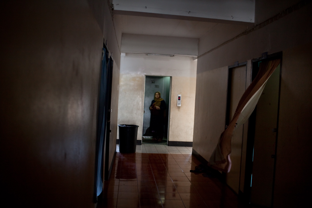 An asylum-seeker uses the elevator in a low income building on the out skirts of Bangkok. The most common struggle is that people can't support themselves financially due to an expired visa. Apr. 2015
