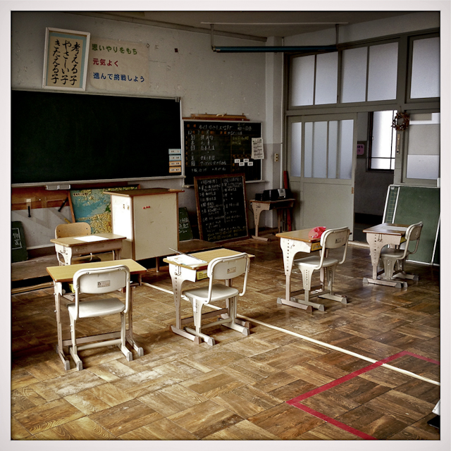 Empty school desks remain in a classroom at Oda elementary. The school has roughly 40 kids total.