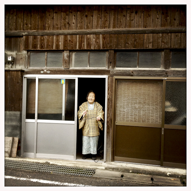 Tsuyako Takeda, a local karaoke singer who sings every day at 7 am from the doorway of her home on Main St.