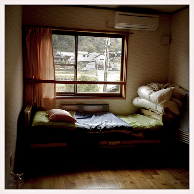 An empty bed room at Kouyou-no-Sato, a group home located in the center of town. It's home to 40 to 50 seniors who lived most of their lives in the small town of Oda, Japan.