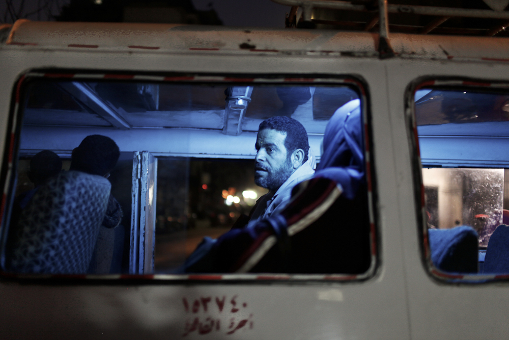 A bus passes by protesters in Downtown Cairo. 2011