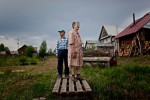 Korukaeva Aliza Ignatievna , 80, and her son Evgeniy stand in the front yard of their home in Zaton, Russia. Korukaeva was exiled with her family to the Komi Republic from Ukraine in 1933. 