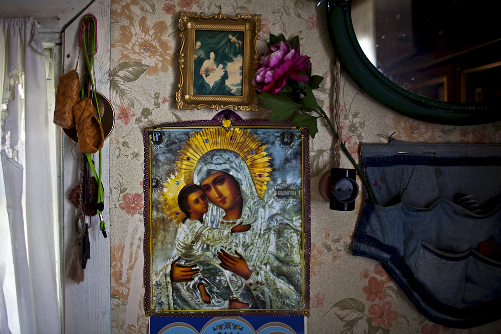 The Madonna and the Christ child hang on the wall, at the home of Ungelfug Gennadiy Rihardovich. Korotkeros, Russia.