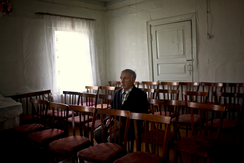 Bekk Villi Oskarovich, sits in the Lutheran church after Sunday mass in Syktyvkar. He was held in captivity in a labor camp for years.  He is originally from Ukraine,  but lives in Syktyvkar, Russia.
