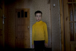 Dima Dmitry, 8, a fourth generation Russian German, stands for a portrait at home in Korotkeros, Russia.